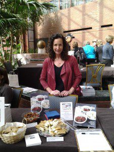 Offering samples of mandelbrot-biscotti and eggplant caponata at the Virginia Festival of the Book in Charlottesville, Va., March 2014